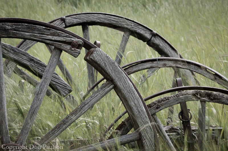 Old wagon wheels in field - Canada, British Columbia, near Cache Creek, Historic Hat Creek Ranch