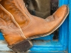 Old cowboy boots in window, Taos, New Mexico