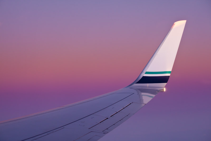 Alaska Airlines Passenger Jet wing at Sunset