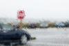 Washington; car at stop sign in rain