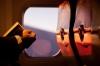 Passenger aboard jet reading a book
