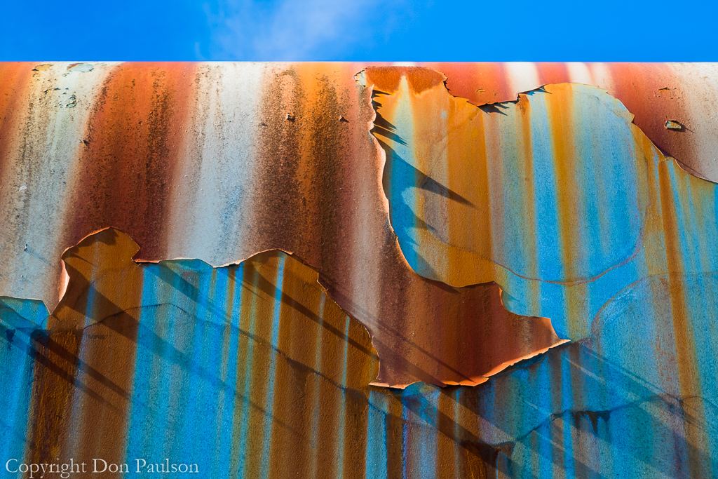 Rust streaks and peeling paint on an old travel trailer - Alaska, Craig