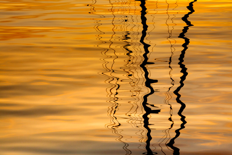 Sailboat mast reflection at sunset, San Juan Islands,