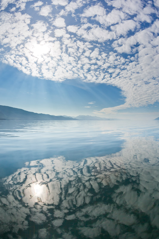 clouds reflected in water near Freshwater Bay, Southeast Alaska
