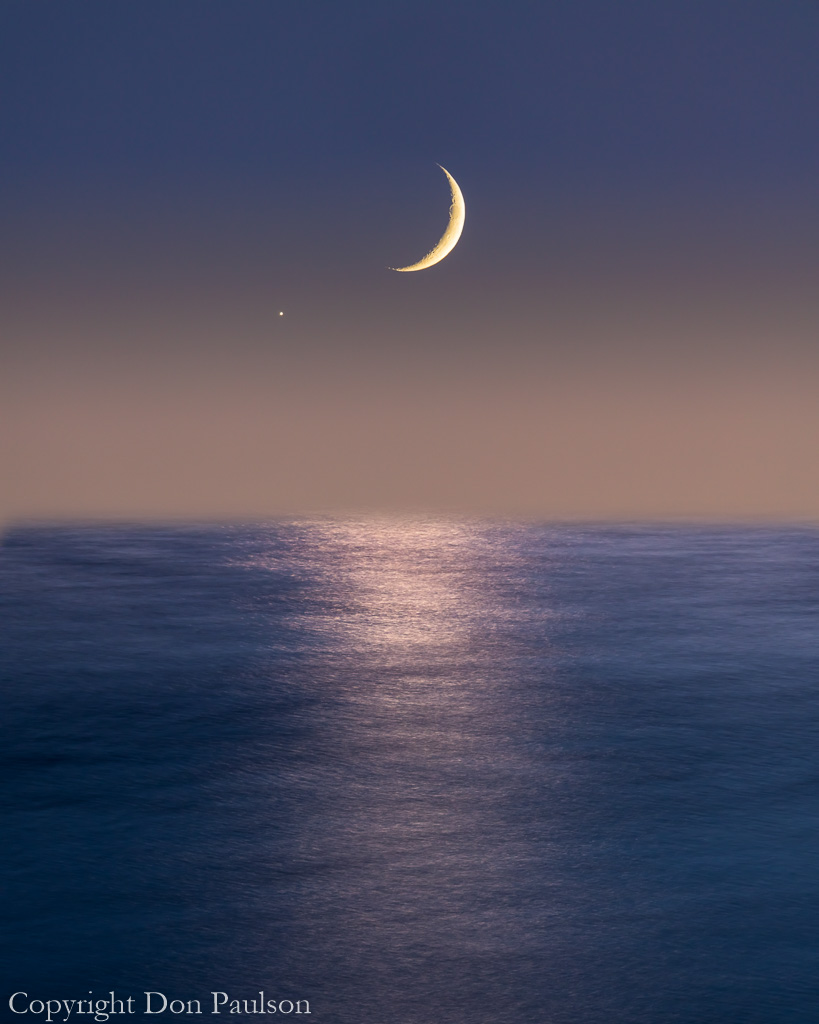 Moon and Venus setting over The Sea